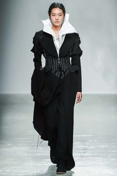 Aganovich - The piecing of the fabrics in this collection was so great because they took contrasting motifs such as pinstripes and florals and made them work well together. thestyleweaver.com Fall 2015 Ready-to-Wear