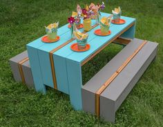 "Cool Kids' Picnic Table: Who says the ""kids' table"" has to be a second-class seating arrangement when you gather for meals? This cool table will have kids clamoring for a seat, and adults wishing they could fit. Whether you use it outdoors or inside, it's sure to be one of the best seats in the house. Find the FREE project plan, along with many others, at buildsomething.com"