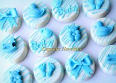 Online Shipping! Delicious custom Baby Shower Baby Boy Girl Chocolate-covered Oreos! Includes handmade edible bows, bibs, cute footprints, rocking horse, teddy bears & rubber duckies on yummy Oreos! Makes a unique and cute gift for new parents too!