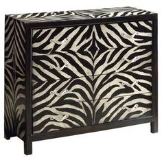 """Four-drawer wood chest with a zebra stripe motif.   Product: ChestConstruction Material: WoodColor: Black and creamFeatures: Four drawersDimensions: 37.5"""" H x 42"""" W x 16"""" D"""