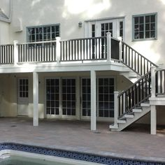 Second story deck done in Trex Transcend Island Mist using hidden clips with Trex Transcend White Posts with Gravel Path Railing and Black Balusters.  Fascia, Stringers, Risers and Posts wrapped in Azek PVC Trim.  Deck was in Port Washington, NY.