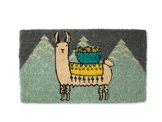 Larry the Llama Doormat from Uncommon Goods. Llama wearing blanket & carrying basket. Mountains. Coir fiber. 14 uncommon doormats. Offbeat Home