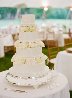 Tiered Wedding Cake with Flowers | photography by http://www.jenfariello.com/