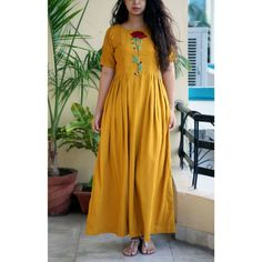 Embroidered yellow color stitched kurti in cotton fabric. in india Simple Kurti Designs, Half Saree Designs, Kurta Designs Women, Pakistani Formal Dresses, Indian Dresses, Yellow Kurti, Yellow Wedding Dress, Frock For Women, Women Wear