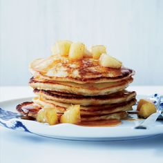 The secret to these fluffy, moist pancakes is fresh ricotta cheese and egg whites. The best part: the buttery, sweet apples piled on top. Crepes, Lemon Ricotta Pancakes, Banana Pancakes, Pancakes And Waffles, Fluffy Pancakes, Apple Recipes, Wine Recipes, Cooking Recipes, Pancake Recipes
