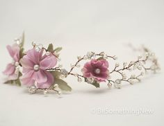Wedding hair vine made from ivory pearls and rhinestone flowers on dark copper-brown wire with lilac flowers to one side. It is made from sturdy wire to shape to fit, and has small loops for bobby pins at each end. This would be beautiful for a garden or woodland wedding. If you want I