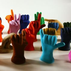 sweet little sculptures depicting the ASL (American Sign Language) alphabet...the artist takes orders for custom words and phrases