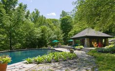 A backyard oasis with a splash of art. This rugged pool house shares arts and crafts sensibilities with an Adirondack lodge.