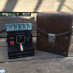My favorite Polaroid onestep rainbow is the black one! for sale in my etsy shop! Polaroid Cameras, Vintage Cameras, Leather Bag, My Etsy Shop, Buy And Sell, Rainbow, My Favorite Things, Bags, Stuff To Buy