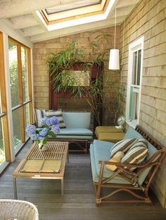 My porch is long and narrow like this one....maybe just a small wicker loveseat and chair