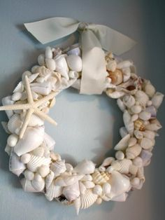 "Make a seashell wreath for summer! It looks pretty easy — all you need is lots of seashells, a foam wreath, ribbon and hot glue. Tutorial available at ""My Romantic Home."""