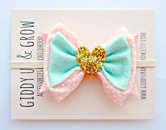 TONS of cute unique hair accessories. Love this sop. Baby Bow Headband - Vintage Fabric Pink and Mint with Gold Glitter Heart.