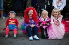 Anniston Spencer, 1, Annamae Spencer, 3, Harper Middleton, 3, and Reagan Middleton, 5, were excited to catch candy at the annual Caufields Halloween Parade on Oct. 11, 2013.