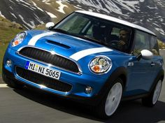 Mini Cooper S - Lightening Blue with white bonnet stripes, British flag hard top, black leather interior w/ blues trim. WANT