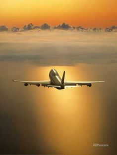 Airplane Flying Through Clouds Photographic Print by Peter Walton at AllPosters.com