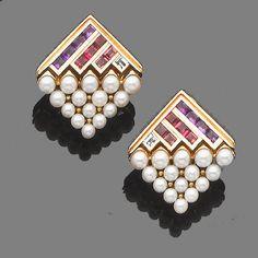 A pair of gem-set earclips, by Bulgari