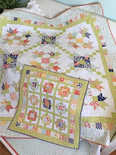 Charm pack patterns by Carried Away Quilting: Purely Petals and Wallflowers; Charm Pack Quilt; Scrappy Quilt; Coney Island fabric by Fig Tree for Moda