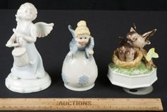 THESE ARE THE PERFECT PIECES FOR YOUR BABY NURSERY - A CHARMING GROUPING OF PORCELAIN FIGURINES INCLUDING A BABY ANGEL BELL, A LOVELY ANGEL PLAYING A DRUM, AND AN ADORABLE HANDPAINTED BIRD MUSIC BOX