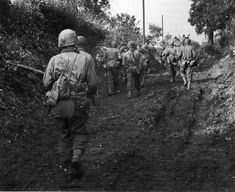 A team of American guns, accompanied by infantry advancing on Übach-Palenberg in late 1944.