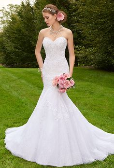Brides: Group USA. Strapless mermaid gown with beaded lace applique and tulle skirt.