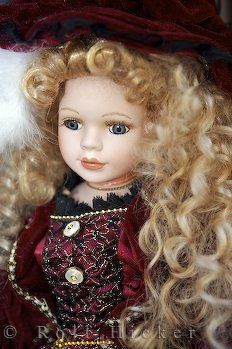 An elaborate and elegant porcelain doll features pretty long curly hair and victorian style clothing. Victorian Dolls, Antique Dolls, Pretty Dolls, Beautiful Dolls, Victorian Style Clothing, Japanese Tea Set, Santa Outfit, Asian Doll, Bisque Doll