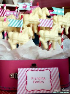 white chocolate molded candy for cupcake toppers. carousel party idea.