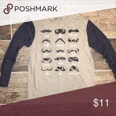 babyGap size 4 Long Sleeved Mustache Graphic Tee babyGap size 4 Long Sleeved Mustache Graphic Tee. Beige body, navy sleeves. GAP Shirts & Tops Tees - Long Sleeve