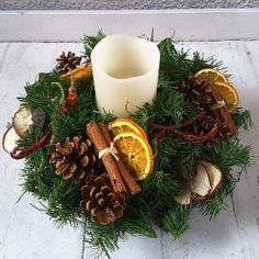 Small ARTIFICIAL Christmas Table Centre on a foam base with an LED Battery Candle, batteries included, and decorated with dried fruits, pine cones and cinnamon sticks. Christmas Flower Arrangements, Christmas Flowers, Natural Christmas, Christmas Candles, Minimal Christmas, Christmas Advent Wreath, Christmas Table Decorations, Christmas Holidays, Christmas Crafts