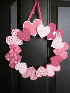 Valentine's day wreath- they do it with wooden hearts but I might make some out of cardstock and let the kids make these as a craft.