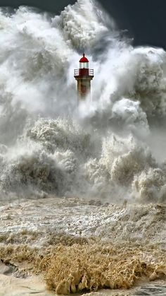 Massive waves! Love the lighthouse peeking out from the water....