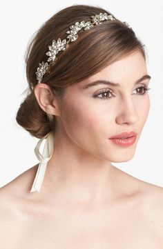 This headband gives off a soft vibe that complements an equally romantic dress. | See more glam headbands here: http://www.mywedding.com/articles/glam-headbands-for-brides-and-bridesmaids/