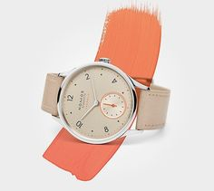 Minimatik champagne: Slender, automatic, elegant... and a bit cheeky with a dash of neon orange embellishing the champagne-colored dial.