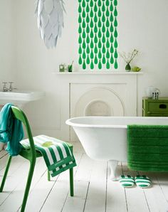 I love the starkness of the white and green, but I especially love the claw-foot tub. My grandma had one of those in her Victorian house and I loved taking baths in there..