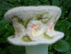 Love this hat... and the needle felting and beading is gorgeous!!