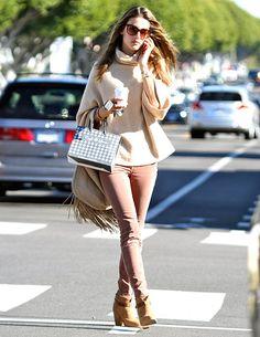 Alessandra Ambrosio -- Sunglasses, Thierry Lasry, $375; Watch: Rolex, approx. $8,000; Jeans: Joe's, $158; Boots: Rag & Bone, $500; Bag: Savatore Ferragamo, approx. $2,600;  Total: $11,633