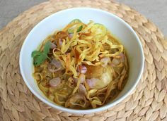 Homemade authentic Khao Soi (Northern Thai coconut curry noodles). Get the recipe here!