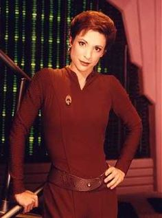 Kira Nerys was a colonel in the Bajoran Militia, following years in the Bajoran Resistance during the Cardassian Occupation and a Starfleet commander for a brief period in 2375. She served as Bajoran liaison officer on Starfleet station Deep Space 9 and later assumed command of the station. Kira was integral in the survival of the Cardassian Rebellion against the Dominion.