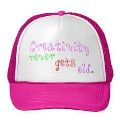 """Fun """"Creativity Never Gets Old""""  Original Slogan Quote saying.  Pretty trucker Hats in a colorful cool font.  Pink White hat shown.  Choose YOUR color hat.  100% nylon mesh back keeps you cool, adjustable.  Visit Store for design on T-shirts & Mugs for All Ages.  Original Slogan Quote Text saying & Graphic Design © TamiraZDesigns via:  www.zazzle.com/tamirazdesigns*"""
