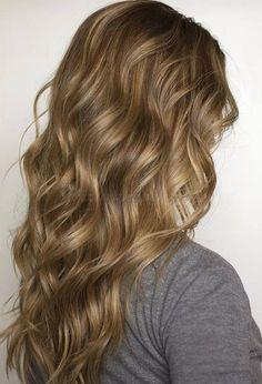 női+frizurák+hosszú+hajból+-+hosszú+hullámos+haj