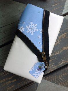 Zipper Gift Wrap with A little Christmas Whimsy. http://www.pinterest.com/bethob/wrap-it-up-with-a-little-whimsy/