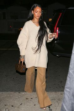 Rihanna wearing Louis Vuitton X Frank Gehry Twisted Box Bag, Hearts on Fire Diamond Necklace and Hearts on Fire Diamond Martini Stud Earrings