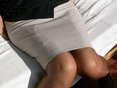 Visible Garter Bumps Under Tight Gray Pencil Skirt