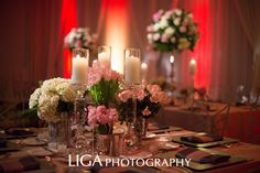 Low centerpiece with acrylic table number Wedding Planner: Lisa Stoner/ E Events Floral: Botanica International Design Studio Acrylic Table #: Amy Morelli/The 2u Collection Photography: Abby Liga/Liga Photography