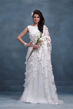 Milan is the ultimate choice for the fashionista in you,Milan offers a wide variety of innovative Customized designs like Kanchipuram sarees , Lehenga Saree White Saree Wedding, Indian Wedding Gowns, Indian Bridal Wear, White Bridal, Modest Wedding, Indian Wear, Christian Wedding Dress, Christian Bridal Saree, Christian Bride