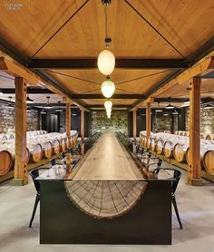 Hall Wines Captures Essence Of The Napa Valley- In the 1885 winery's events space, a custom John Houshmand table combines steel with log slivers.