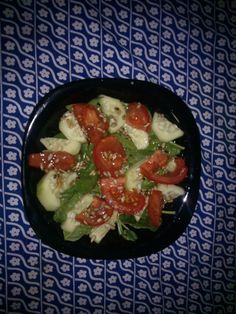 spinach salad, tomato, cucumber and sunflower seeds...