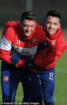 Mesut Ozil and Sanchez fool around...