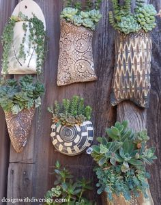 wall pockets ~ you can attach colorful coffee mugs or bowls to a wooden fence ~ gotta try!