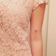 I like the placement. (Tiny heart tattoo.)
