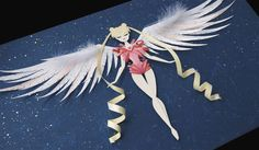 Sailor Moon, mid-transformation, made entirely of paper (and half a feather) - Little Paper Forest